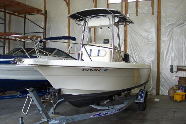 2002 SEA FOX 21' CENTER CONSOLE W/ 150 HP MERC O/B