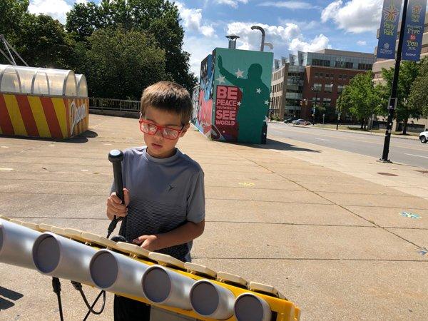A boy plays the marimba at Martin Luther King Jr. park