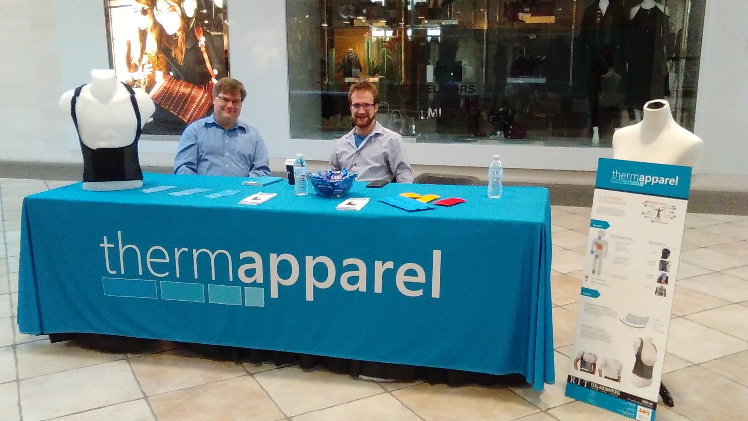 Kurtis Kracke (left) and Brad Dunn (right), tired but present at the Thermapparel table for WalkAbout.