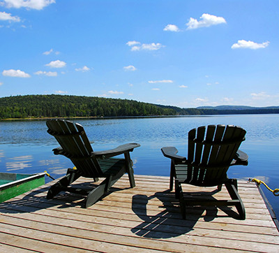 Made in NY Adirondack Chairs with a View of a Lake