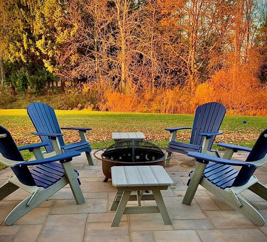 Durable Adirondack Chairs & Tables Around a Fire Pit