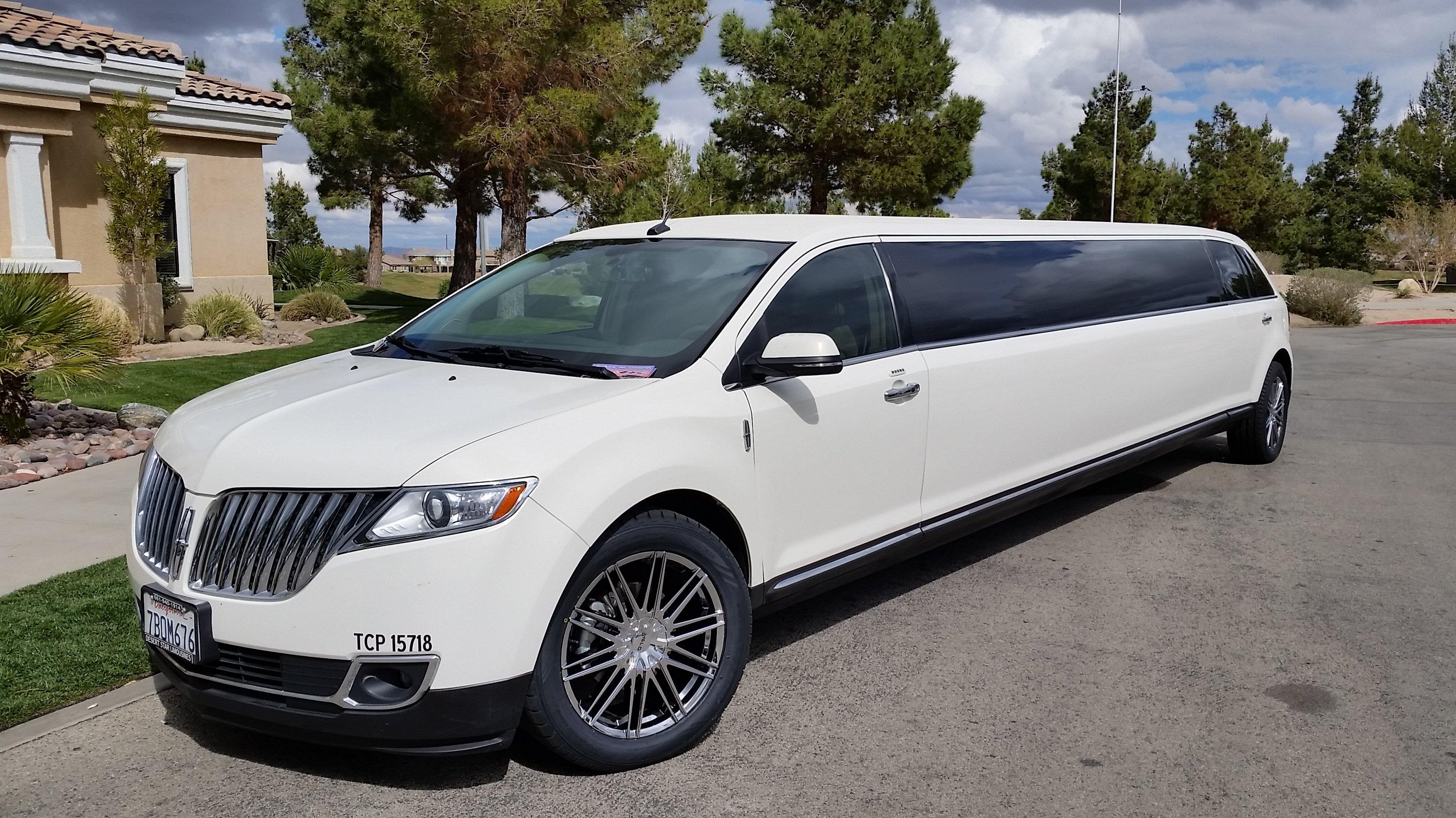 Pearl White Lincoln MKX 12 Passenger Limousine