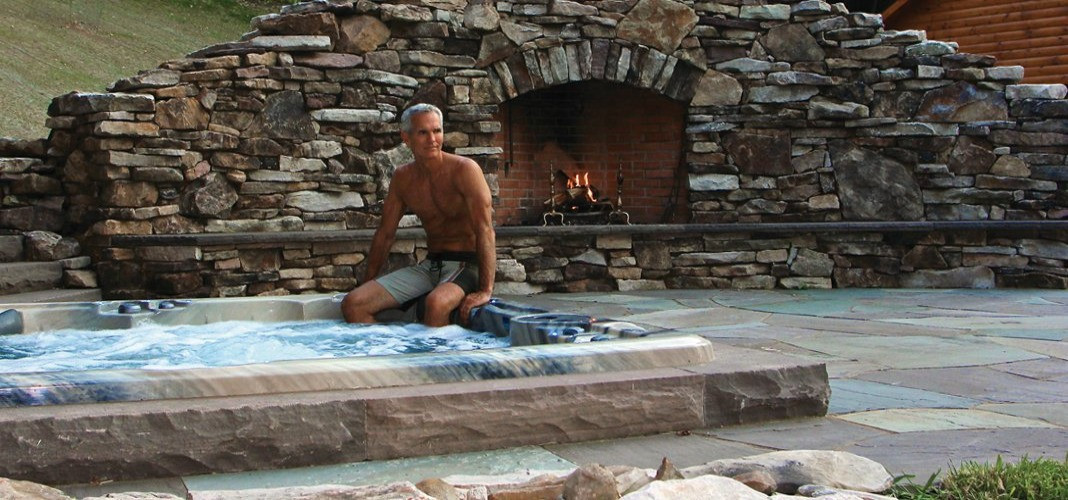 PDC Spas hot tub with fireplace