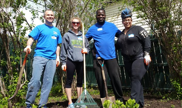 Common Ground Health staff work outside during the 2017 Day of Caring.