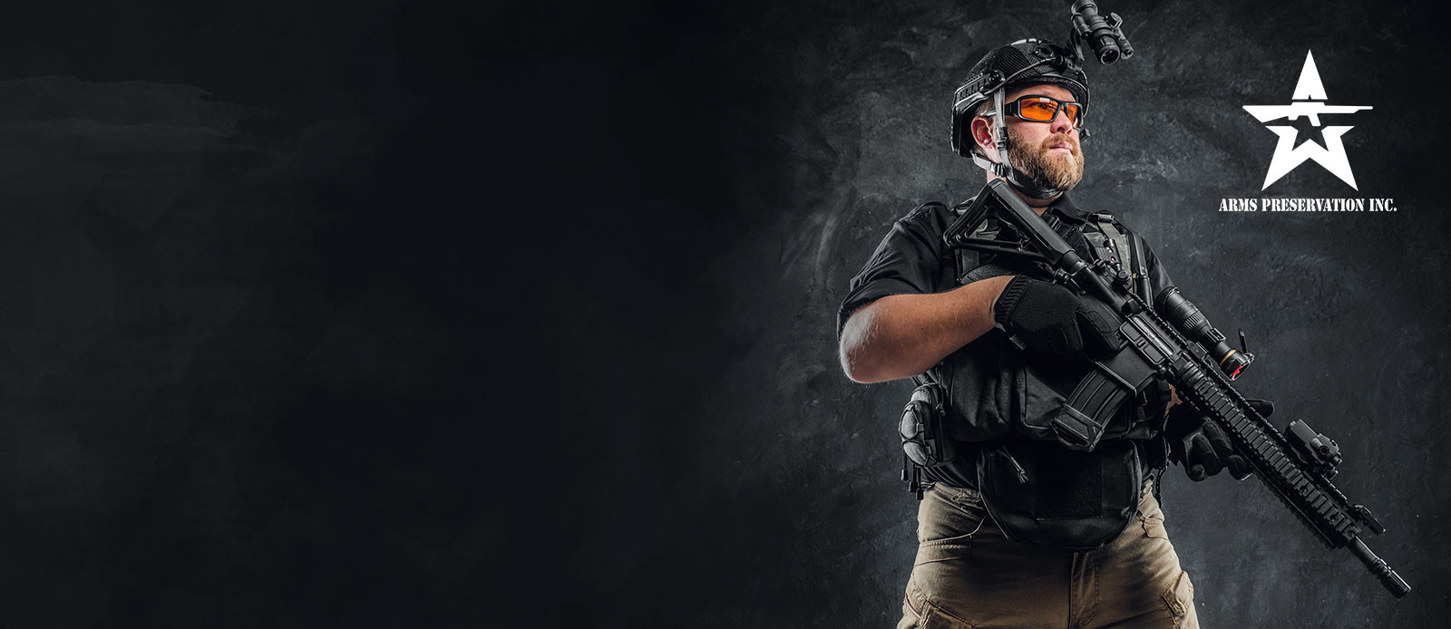 Arms preservation inc. man with tactical gear and holding an AR15