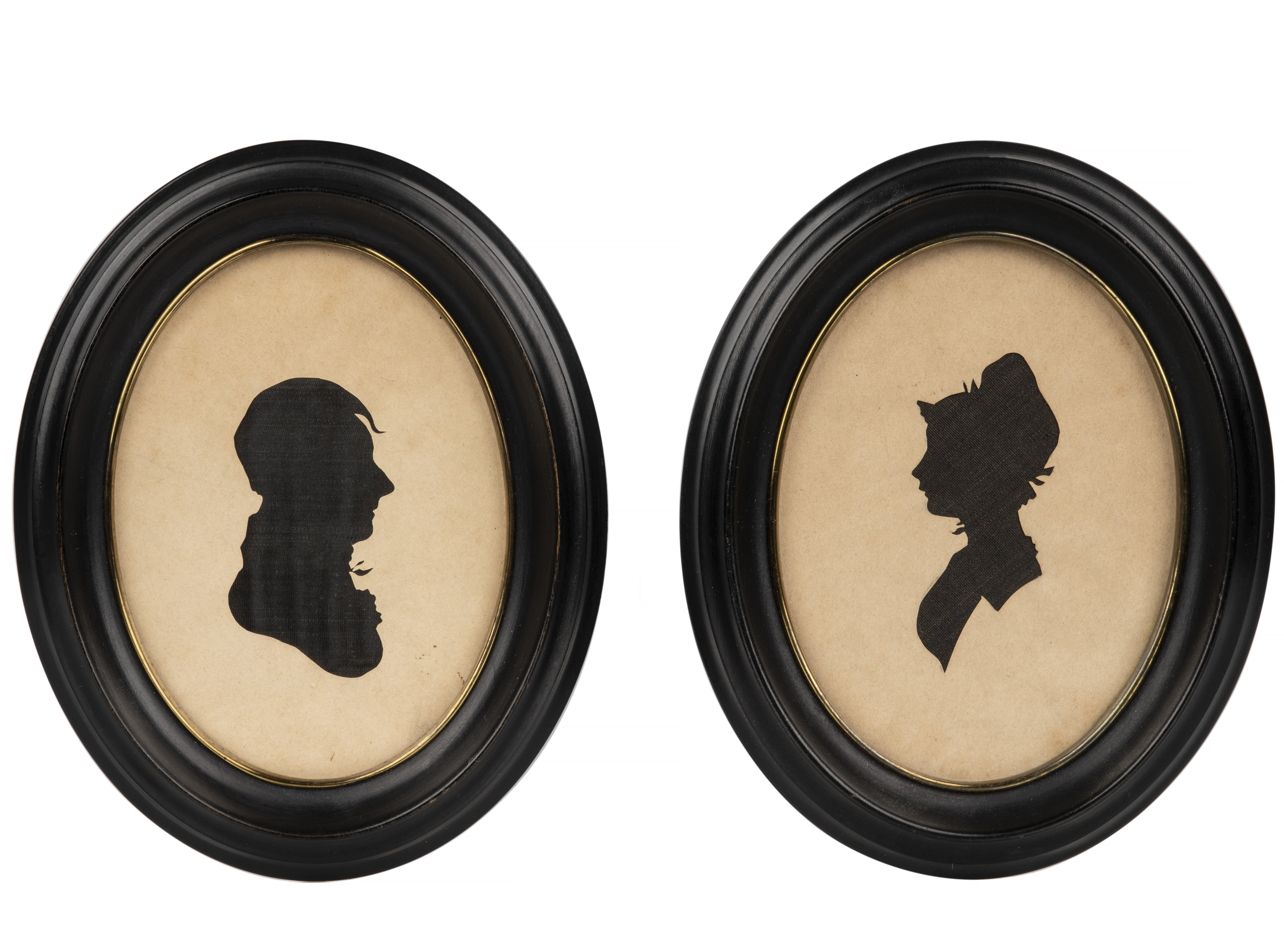 A Pair Of Antique Oval Framed Textile Backed Silhouette Cuts