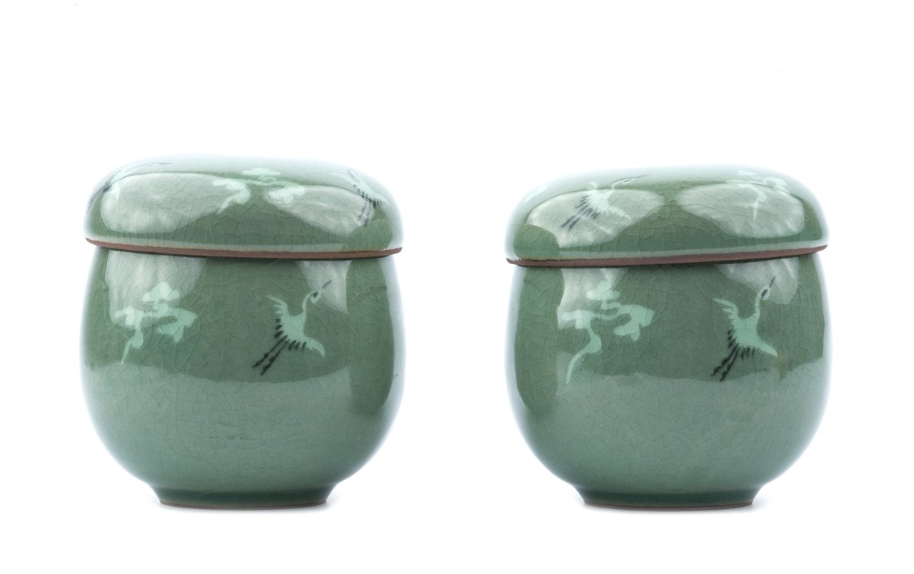A Pair Of Korean Celadon Thousand Crane Pattern Jars & Covers