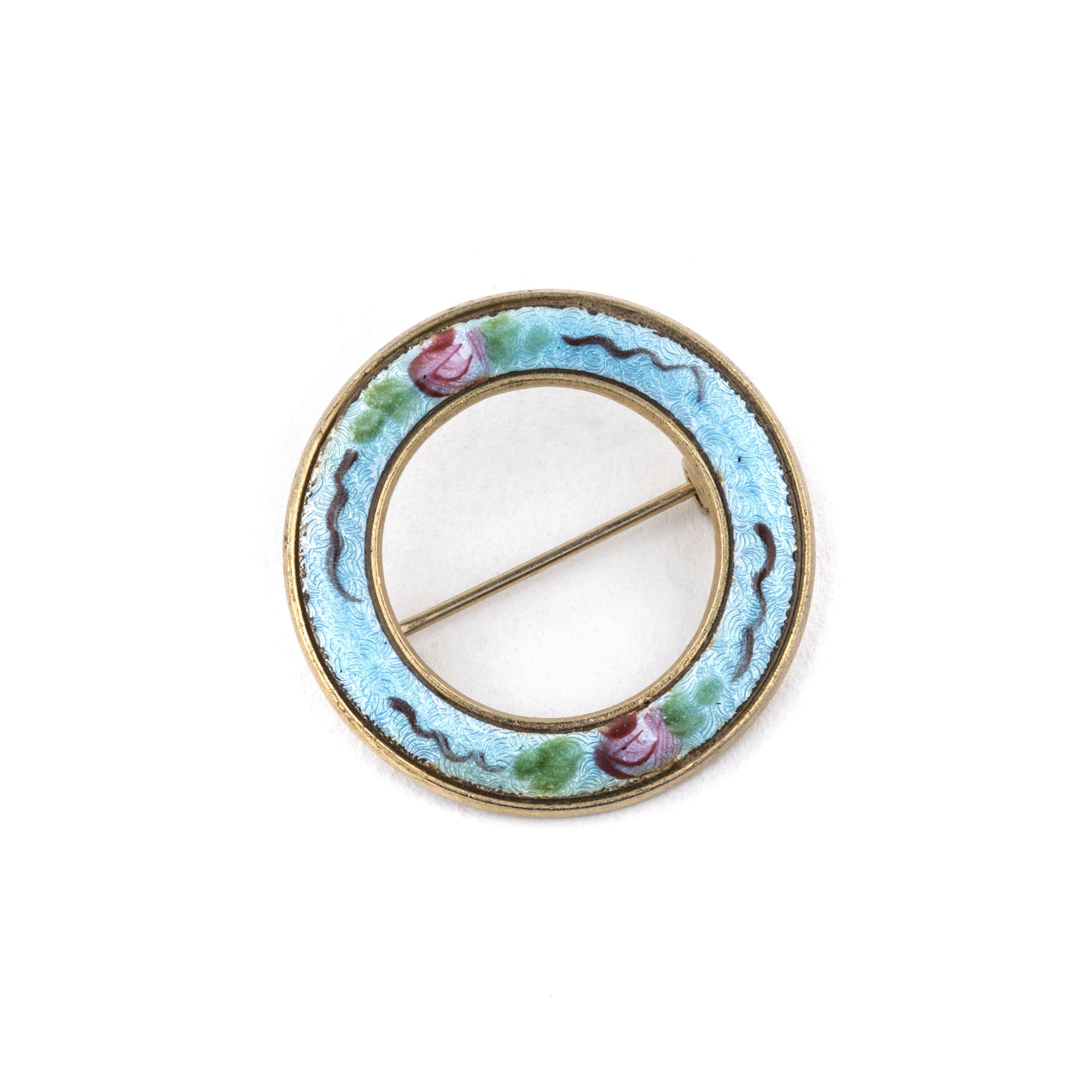 A Vintage Circular Floral Decorated Enamel Pin
