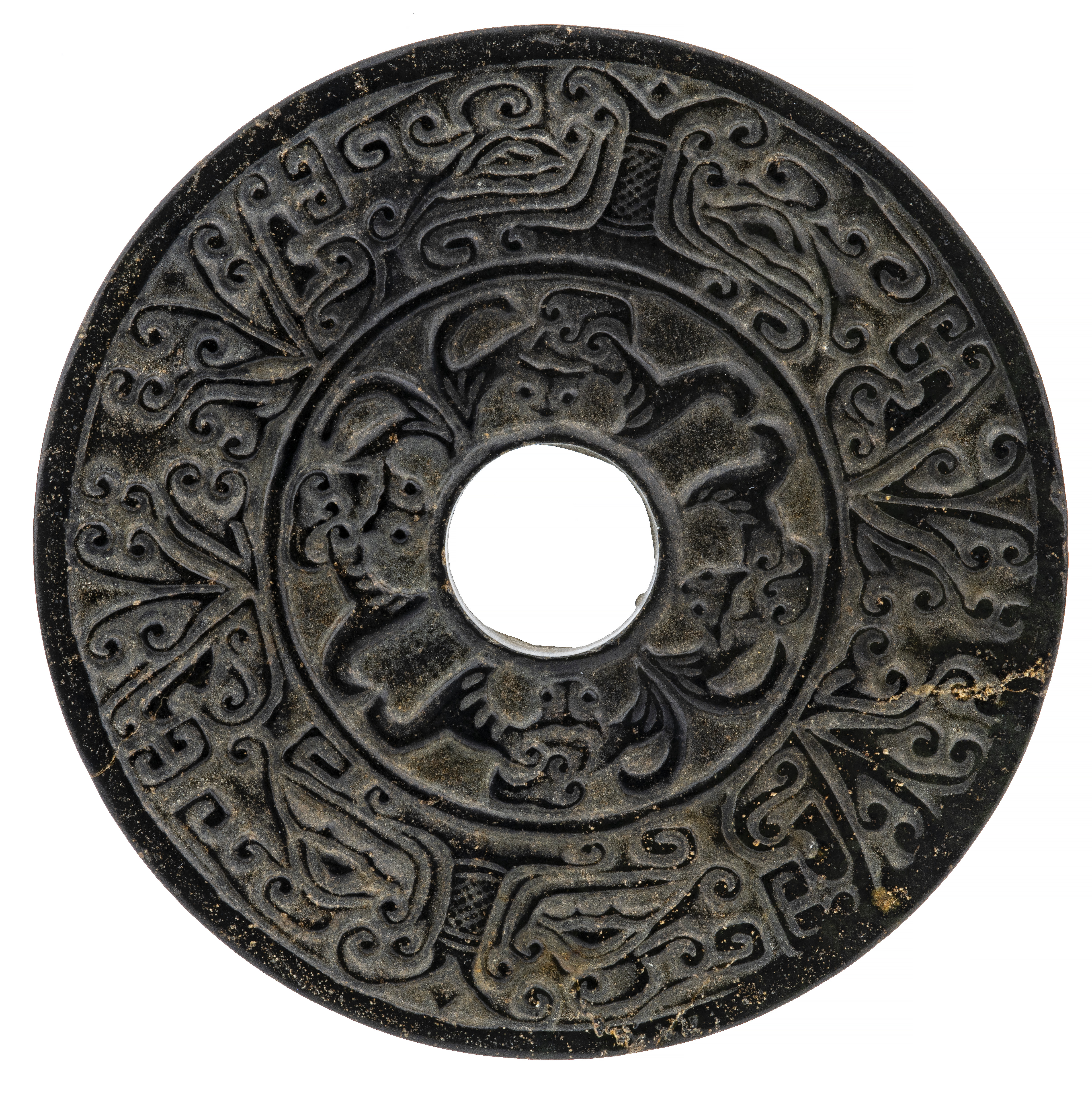 A Spotted Ebony Chinese Carved Archaic Dragon Form Bi Disc