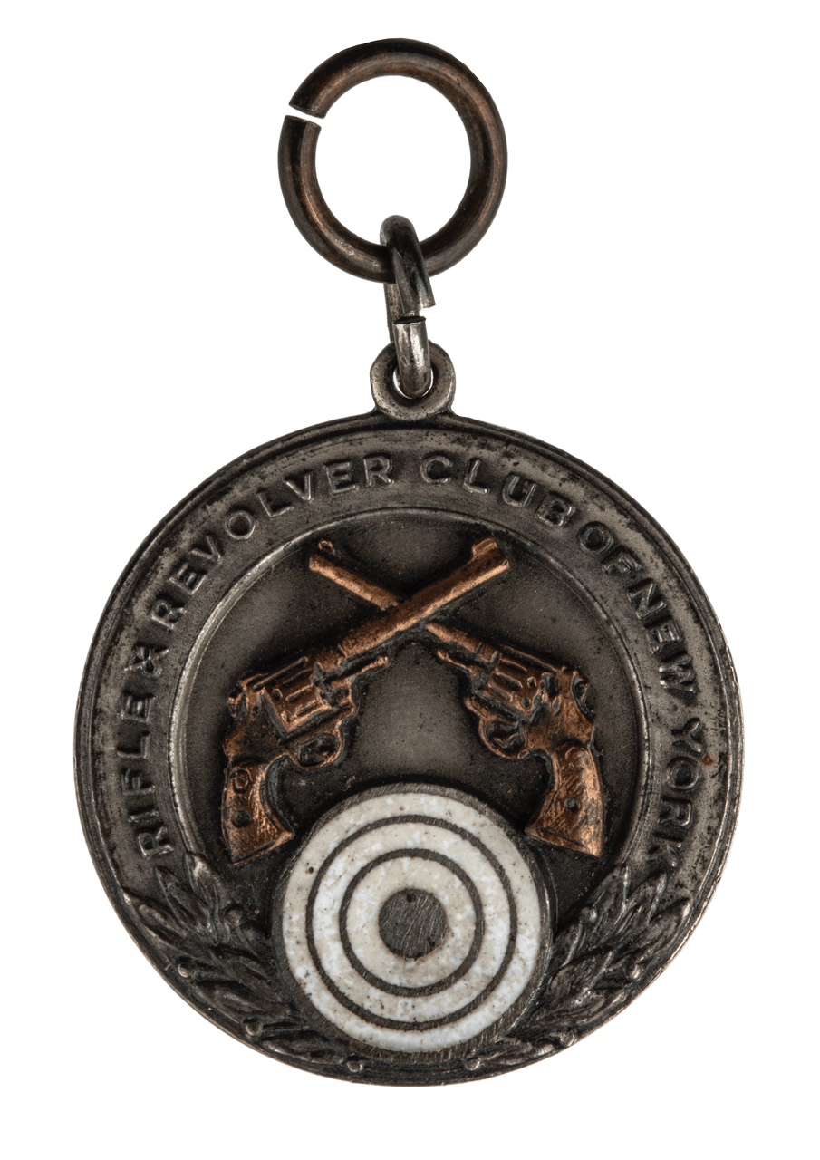 A Sterling Silver & Mixed Metal Enamel Decorated 1930's NY Rifle & Revolver Club Medal