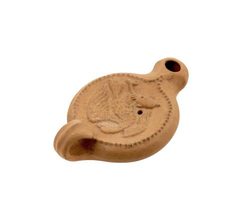 A Roman pottery lamp
