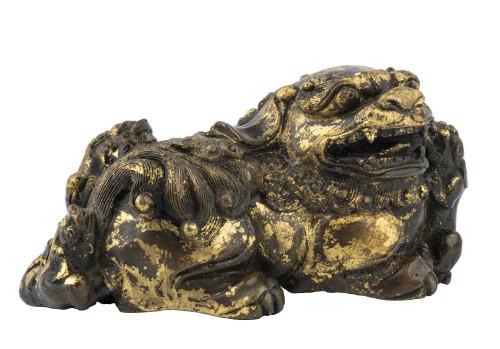 A Chinese Gilt Bronze Figure Of A Buddhist Lion