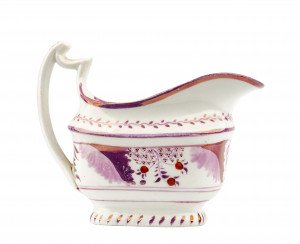 An Antique Lusterware Floral Decorated Gravy Boat
