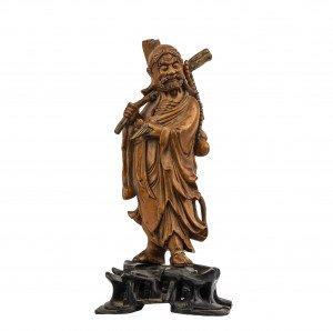 A Chinese Qing Dynasty Period Carved Boxwood Figure Of Li Tieguai