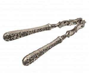 An Antique S. Kirk & Son Inc. Sterling Silver Repousse Pattern Nut Cracker Tongs