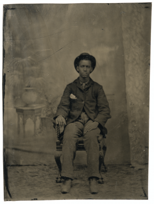 An Antique Tin Type Of A Young African American Man