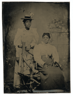 An Antique African American Tin Type Of Two Ladies
