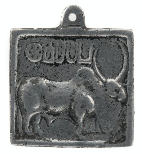A Vintage Indian Metal Sanskit Decorated Pendant