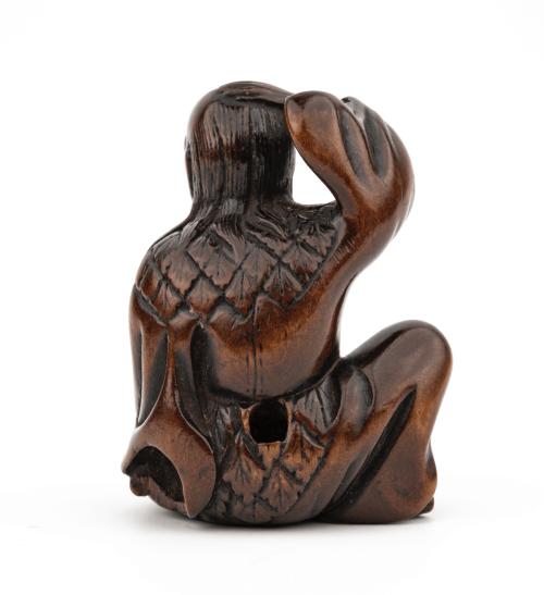 An Edo Era Antique Japanese Wooden Netsuke Of A Man Holding A Frog