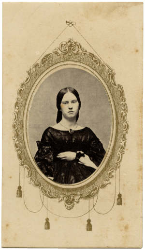 A 19th Century Carte De Visite Photograph Of A Lady In Gothic Attire With U.S. Inter. Rev. 2 Cent Bank Check Stamp 1862-1871