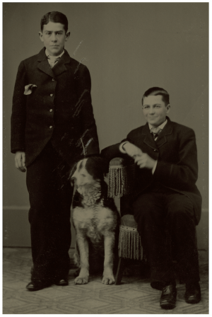 A 19th Century Tintype Photograph of Two Boys & A Dog