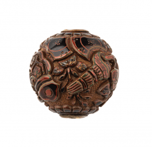 A Meiji Era Japanese Tri-Color Lacquer Carved Ojime Bead