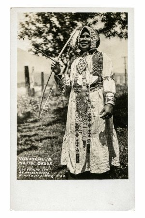 Vintage postcard of an Indian girl in a Native Dress  Winnemucca Nevada, front view