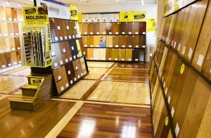 Various hardwood floors and moldings are displayed at a Lumber Liquidators showroom