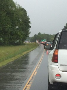 cars on road behind accident