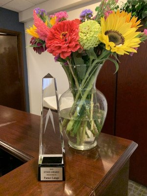 Award with Flowers At Faraci Lange Office